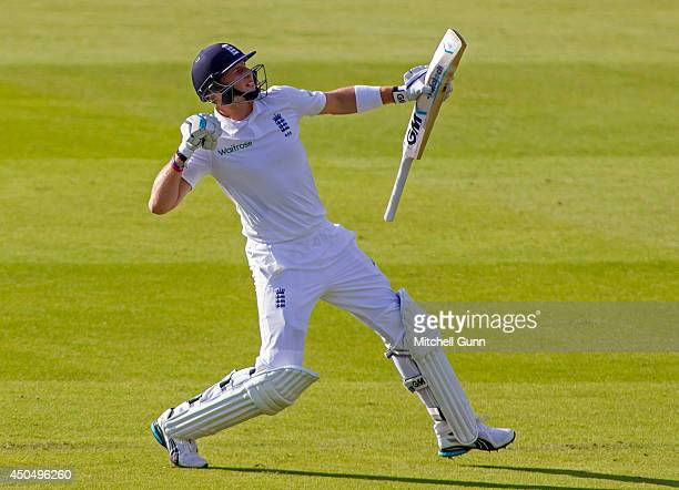 Joe Root of England celebrates scoring a century during the Investec 1st Test Match day one between England and Sri Lanka at Lords Cricket Ground on...