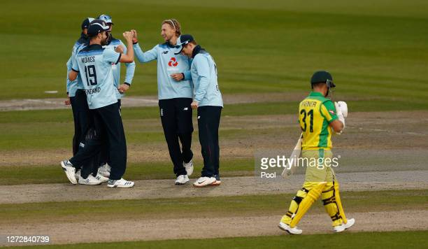 Joe Root of England celebrates the wicket of David Warner of Australia with teammates during the 3rd Royal London One Day International Series match...