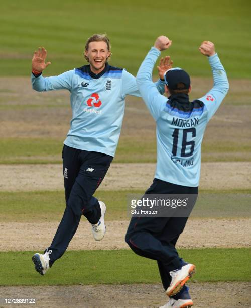 Joe Root of England celebrates the wicket of Mitchell Marsh of Australia with Eoin Morgan of England during the 3rd Royal London One Day...