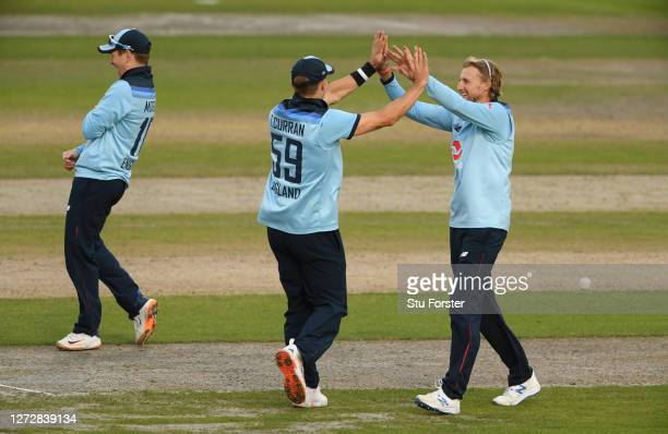 Joe Root of England celebrates the wicket of Mitchell Marsh of Australia with Tom Curran of England during the 3rd Royal London One Day International...