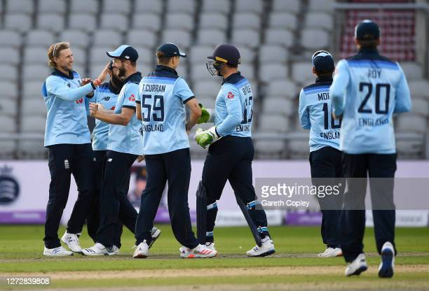 Joe Root of England celebrates the wicket of Mitchell Marsh of Australia with teammates during the 3rd Royal London One Day International Series...