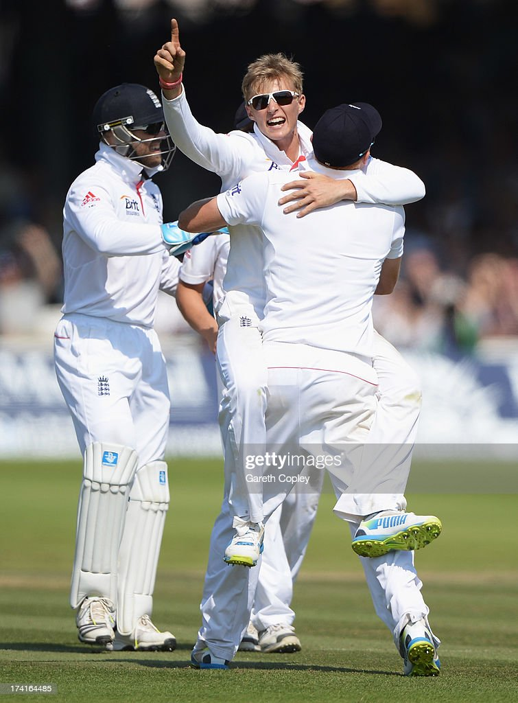 Joe Root of England celebrates the wicket of Usman Khawaja of Australia with team mates during day four of the 2nd Investec Ashes Test match between England and Australia at Lord's Cricket Ground on July 21, 2013 in London, England.