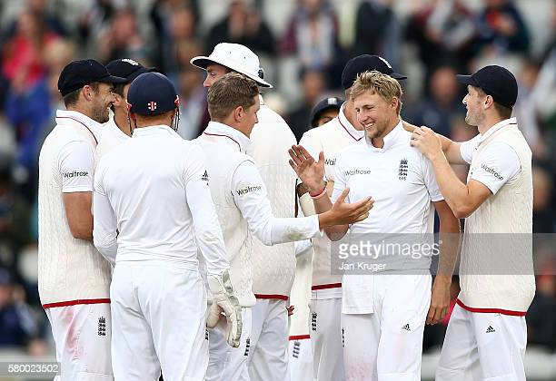 Joe Root of England celebrates the wicket of Wahab Riaz with team mates during day four of the 2nd Investec Test between England and Pakistan at Old...