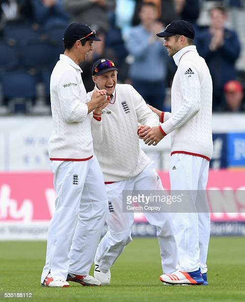 Joe Root of England celebrates with captain Alastair Cook and James Anderson after catching out Dimuth Karunaratne of Sri Lanka during day three of...