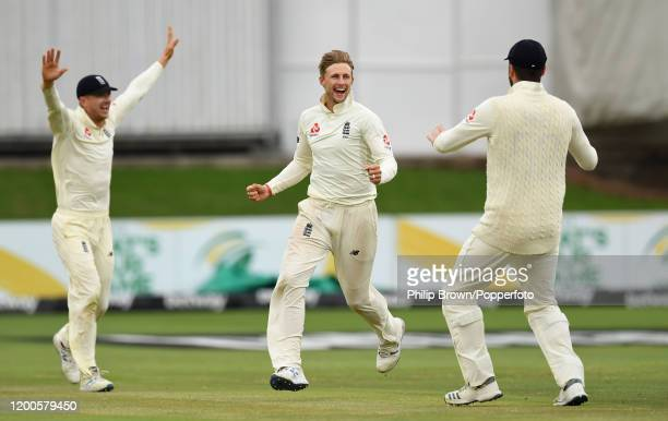 Joe Root of England celebrates with Dom Sibley and Joe Denly after dismissing Faf du Plessis of South Africa during Day Four of the Third Test...