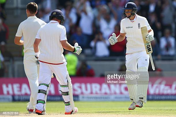 Joe Root of England celebrates with Ian Bell after hitting the winning runs to defeat Australia by 8 wickets during day three of the 3rd Investec...
