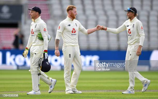 Joe Root of England congratulates Ben Stokes after Day Three of the 1st #RaiseTheBat Test Match between England and Pakistan at Emirates Old Trafford...