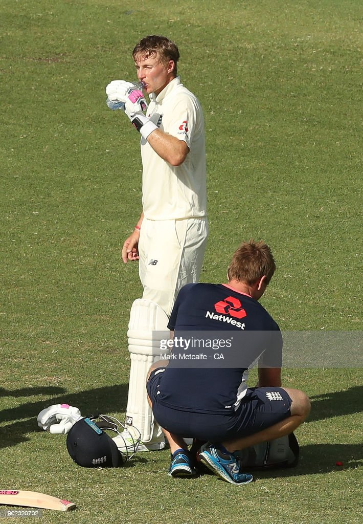 Joe Root of England drinks water as his injured finger is treated during day four of the Fifth Test match in the 2017/18 Ashes Series between Australia and England at Sydney Cricket Ground on January 7, 2018 in Sydney, Australia.