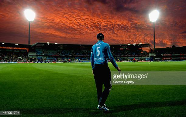 Joe Root of England fields on the boundary as the sunsets during the One Day International Tri Series match between Australia and England at...