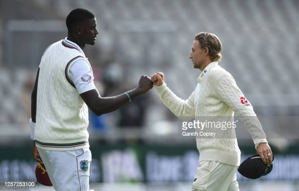 Joe Root of England 'fist bumps' Jason Holder of West Indies after victory on Day Five of the 2nd Test Match in the #RaiseTheBat Series between...