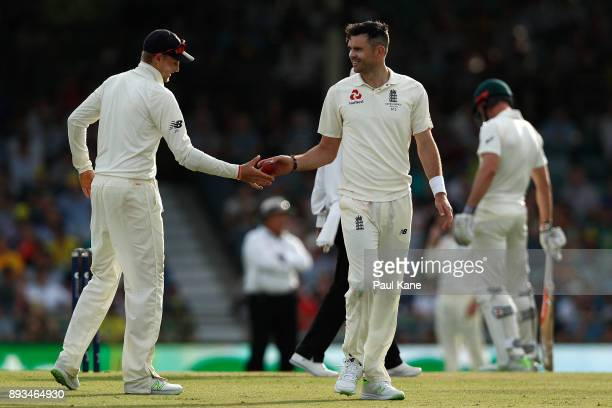 Joe Root of England hands the ball to James Anderson of England during day two of the Third Test match during the 2017/18 Ashes Series between...