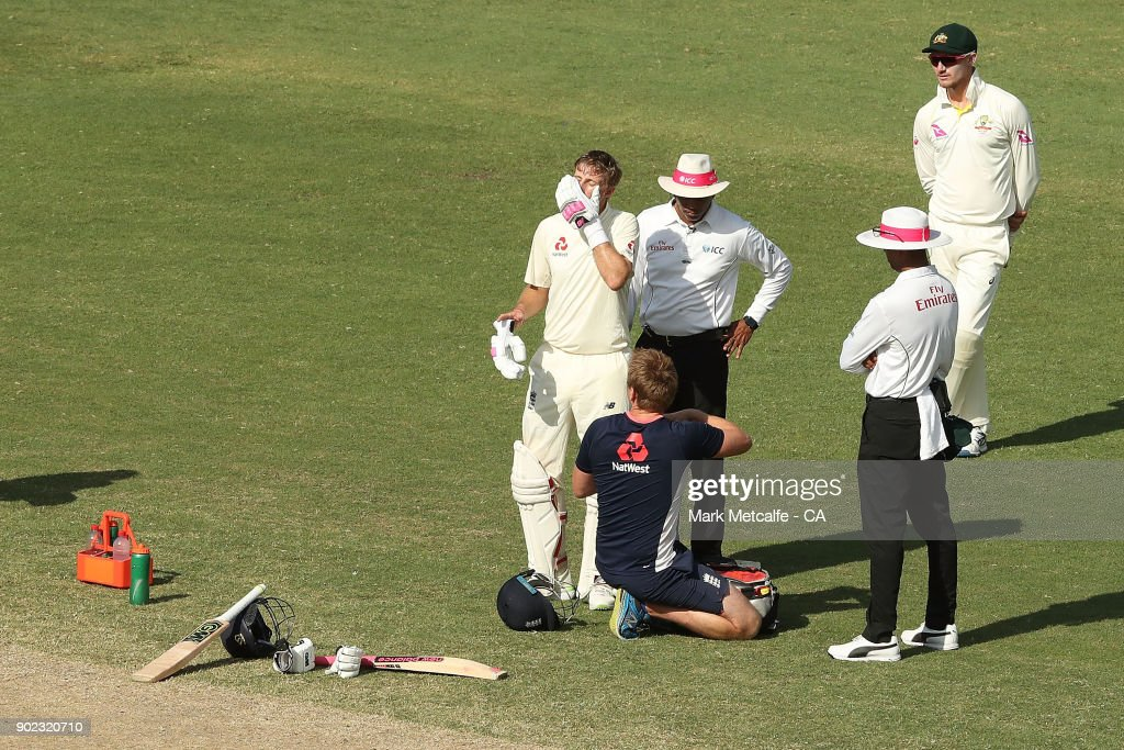 Joe Root of England has an injured finger treated during day four of the Fifth Test match in the 2017/18 Ashes Series between Australia and England at Sydney Cricket Ground on January 7, 2018 in Sydney, Australia.