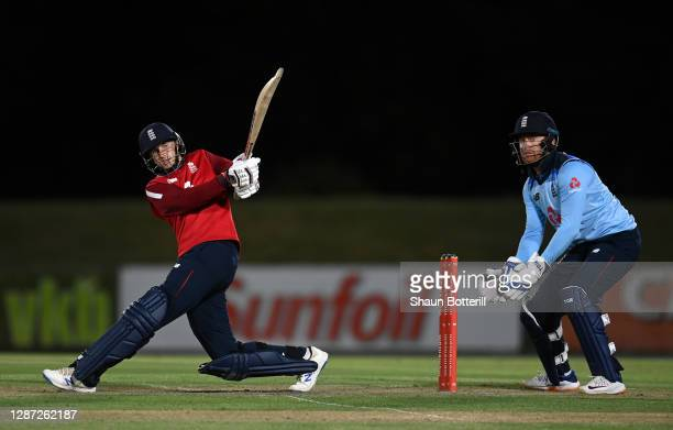 Joe Root of England hits a four as wicket keeper Jonny Bairstow looks on during the warm up match between Team Morgan and Team Buttler at Boland Park...