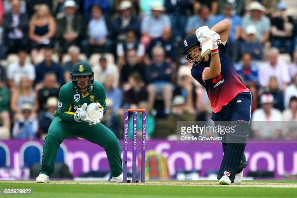 Joe Root of England hits out while Quinton de Kock of South Africa looks on during the Royal London ODI match between England and South Africa at The...