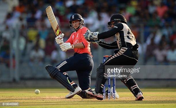 Joe Root of England hits past New Zealand wicketkeeper Luke Ronchi during the ICC Twenty20 World Cup warm up match between New Zealand and England at...