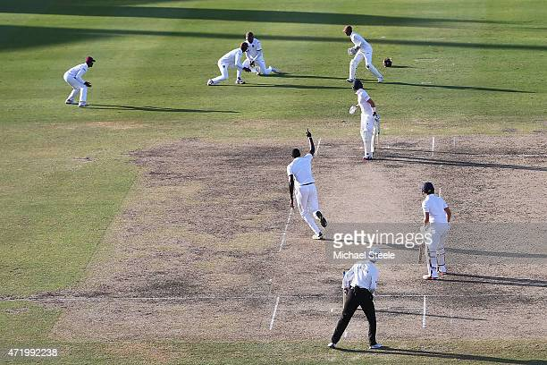 Joe Root of England is caught by Darren Bravo of West Indies at first slip off the bowling of Jason Holder during day two of the 3rd Test match...