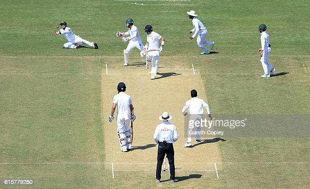 Joe Root of England is caught out by Sabbir Rahman of Bangladesh during the first Test match between Bangladesh and England at Zohur Ahmed Chowdhury...