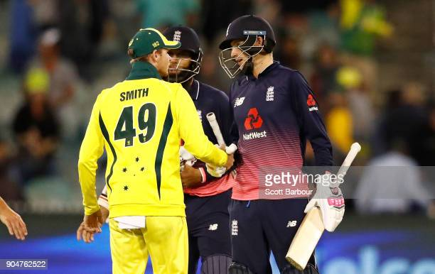 Joe Root of England is congratulated by Australian captain Steven Smith after England won game one of the One Day International Series between...
