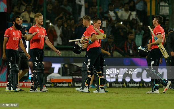 Joe Root of England is congratulated by Eoin Morgan Captain of England as the prior walks back to the pavilion after winning the ICC World Twenty20...