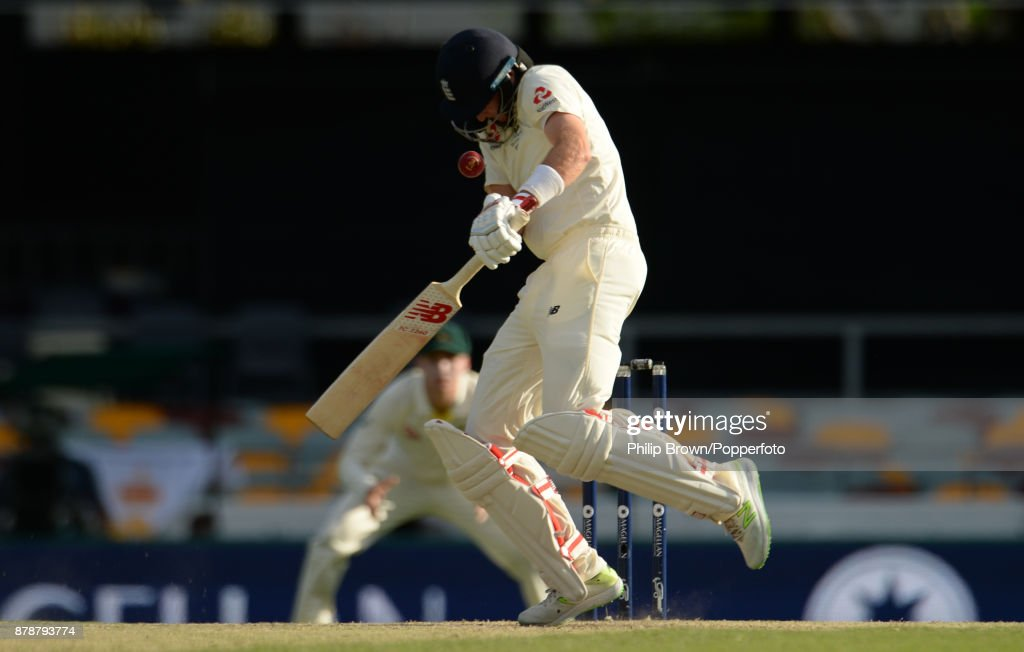Joe Root of England is hit on the helmet by a bouncer bowled by Mitchell Starc of Australia on the third day of the first Ashes cricket test match between Australia and England at the Gabba on November 25, 2017 in Brisbane, Australia.