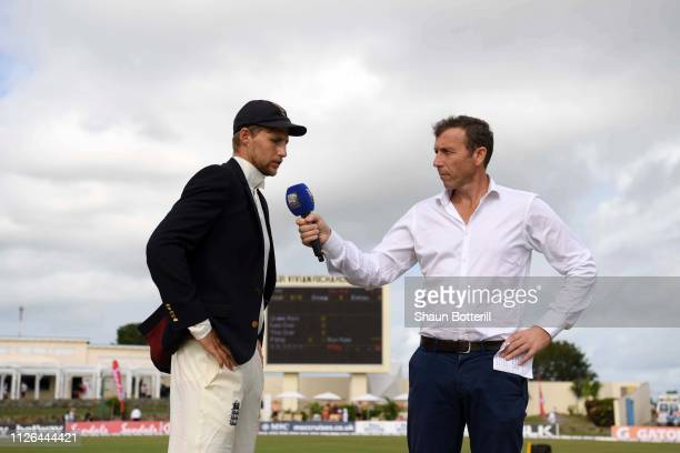 Joe Root of England is interviewed by Sky Sports Presenter Michael Atherton ahead of play on Day One of the Second Test match between West Indies and...