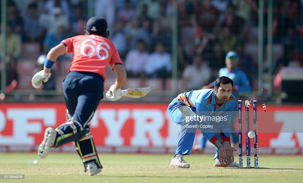 Joe Root of England is run out by Mohammad Nabi of Afghanistan during the ICC World Twenty20 India 2016 Group 1 match between England and Afghanistan at Feroz Shah Kotla Ground on March 23, 2016 in Delhi, India.