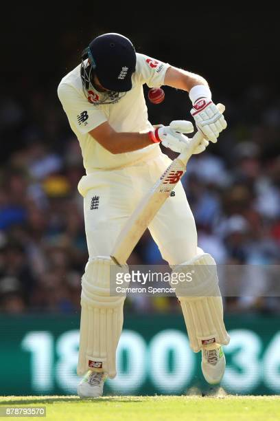 Joe Root of England is struck in the helmet by a delivery from Mitchell Starc of Australia during day three of the First Test Match of the 2017/18...