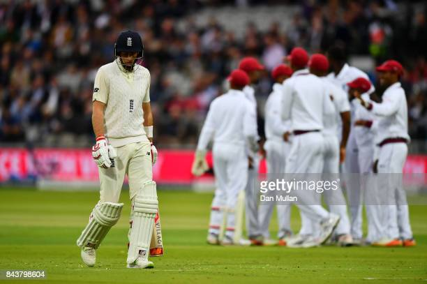 Joe Root of England leaves the field after being dismissed by Jason Holder of the West Indies during day one of the 3rd Investec Test Match between...
