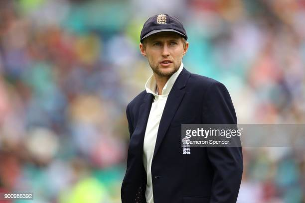 Joe Root of England leaves the field following the coin toss during day one of the Fifth Test match in the 2017/18 Ashes Series between Australia and...