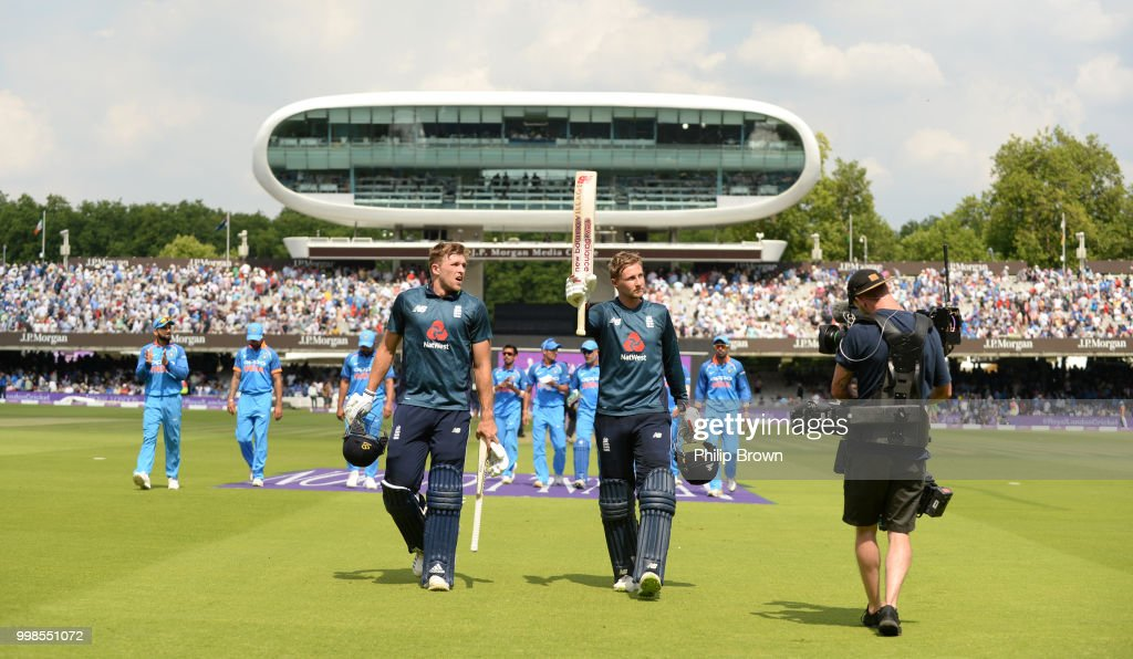 Joe Root of England leaves the field with David Willey after scoring 113 runs during the 2nd Royal London One-Day International between England and India at Lord's Cricket Ground on July 14, 2018 in London, England.
