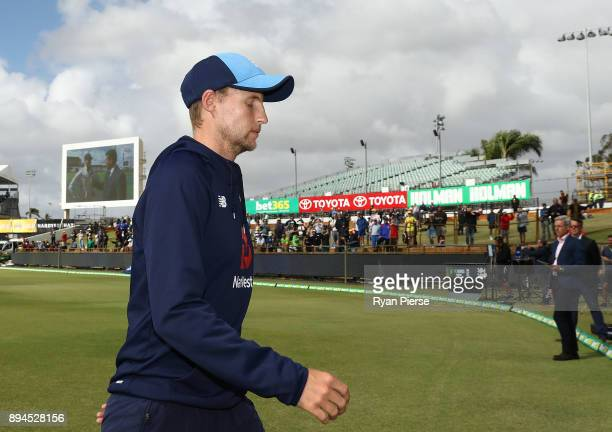 Joe Root of England looks dejected after Australia claim victory during day five of the Third Test match during the 2017/18 Ashes Series between...
