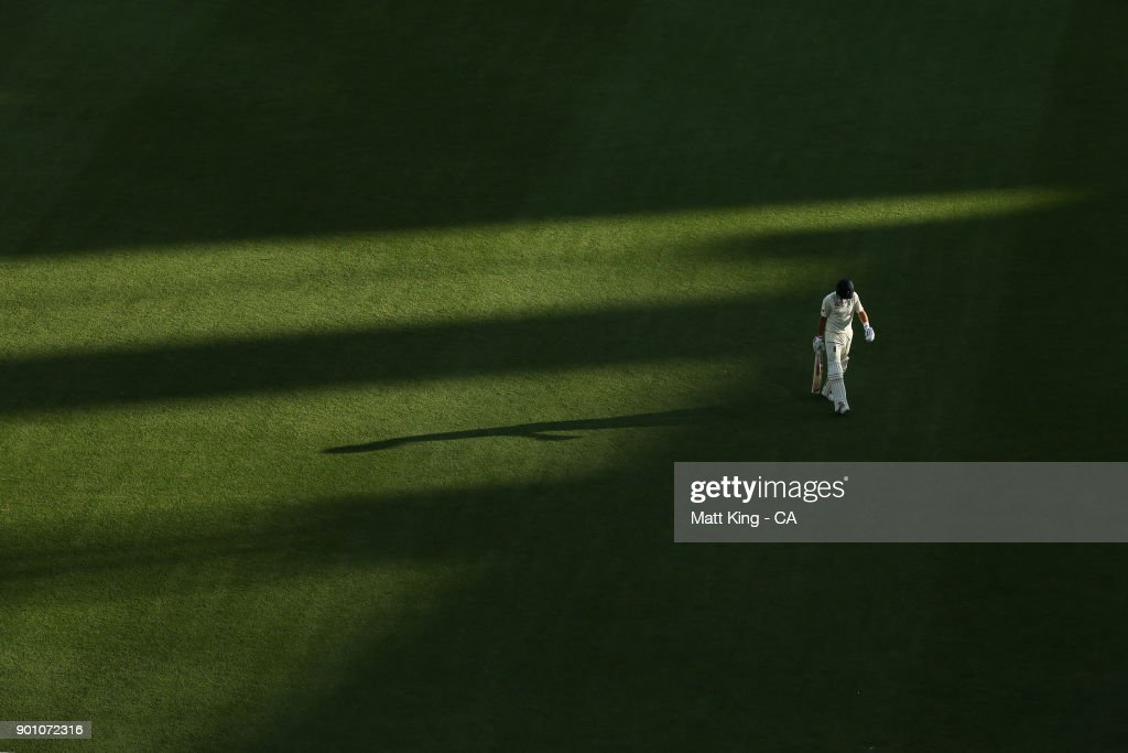 Joe Root of England looks dejected as he walks from the field after being dismissed by Mitchell Starc of Australia during day one of the Fifth Test match in the 2017/18 Ashes Series between Australia and England at Sydney Cricket Ground on January 4, 2018 in Sydney, Australia.