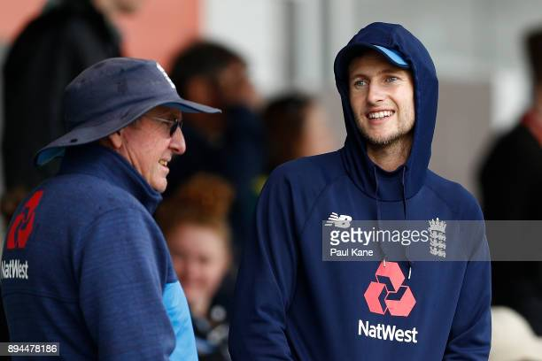Joe Root of England looks on with Trevor Bayliss head coach as rain delays the start of play during day five of the Third Test match during the...