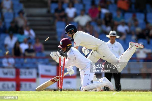 Joe Root of England makes his ground as Shane Dowrich of the West Indies takes the bails off during Day Three of the Third Test match between the...
