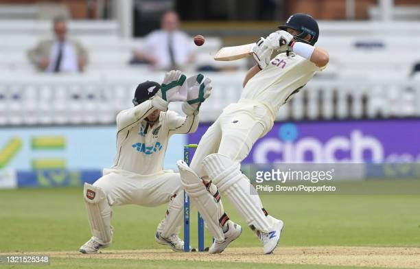 Joe Root of England plays a shot as BJ Watling of New Zealand lifts his gloves during Day 2 of the First LV= Insurance Test match between England and...