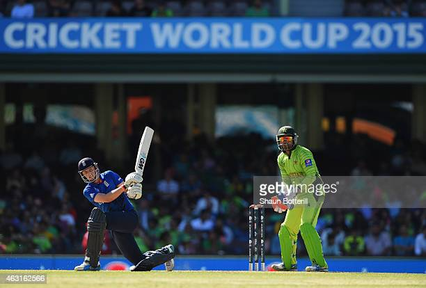 Joe Root of England plays a shot as Umar Akmal of Pakistan looks on during the ICC Cricket World Cup warm up match between England and Pakistan at...