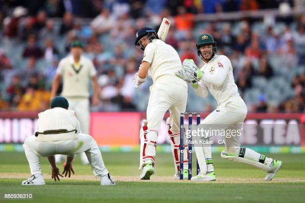 Joe Root of England plays just short of David Warner of Australia as Tim Paine of Australia watches on during day four of the Second Test match...