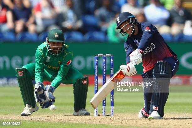 Joe Root of England plays to the offside off the bowling of Shadab Khan as wicketkeeper Sarfraz Ahmed looks on during the ICC Champions Trophy...
