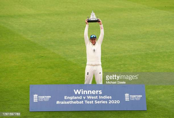 Joe Root of England poses with the Wisden Trophy after England win the series 2-1 during Day Five of the Ruth Strauss Foundation Test, the Third Test...