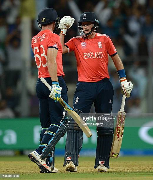 Joe Root of England punches gloves with Jos Buttler after scoring a boundary during the ICC World Twenty20 India 2016 Super 10s Group 1 match between...