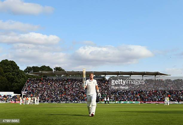 Joe Root of England raises his bat as he leaves the field after being dismissed for 134 runs by Mitchell Starc of Australia during day one of the 1st...