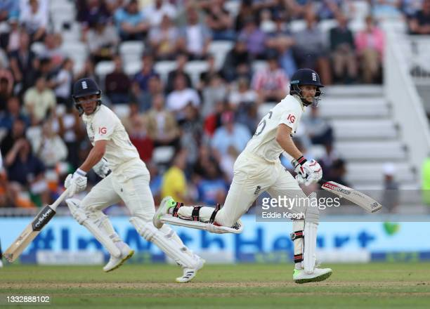 Joe Root of England runs a single with Sam Curran during day four of the First LV= Insurance test match between England and India at Trent Bridge on...