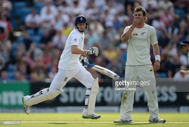 Joe Root of England scores runs past Doug Bracewell of New Zealand during day two of 2nd Investec Test match between England and New Zealand at...