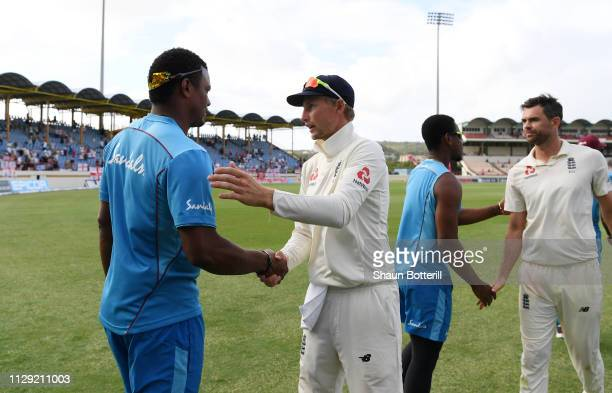 Joe Root of England shakes hands with of the West Indies following England's Victory during Day Four of the Third Test match between the West Indies...