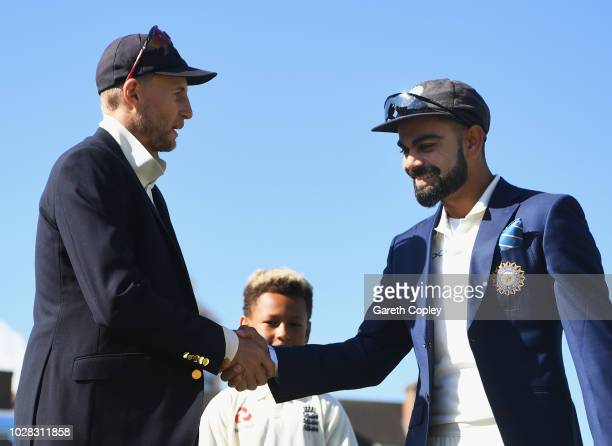 Joe Root of England shakes hands with Virat Kohli of India before Day One of the Specsavers 5th Test match between England and India at The Kia Oval...