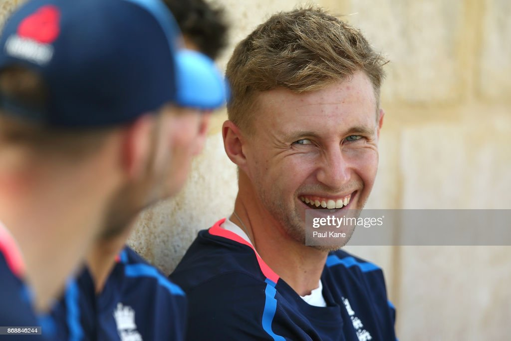 Joe Root of England shares a moment with team mates after batting practice during an England nets session at the WACA on November 1, 2017 in Perth, Australia.