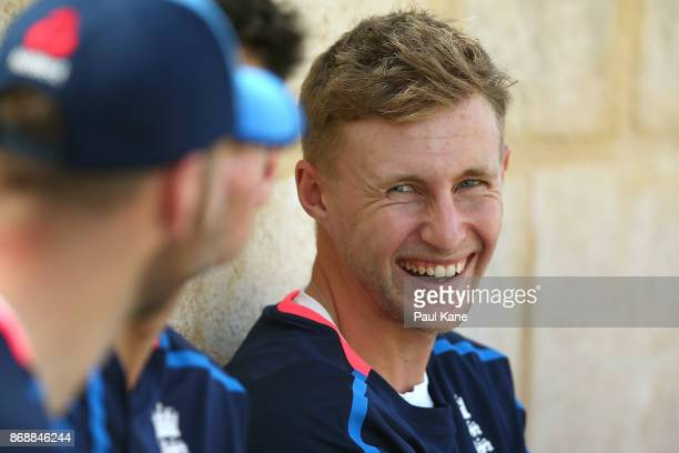 Joe Root of England shares a moment with team mates after batting practice during an England nets session at the WACA on November 1 2017 in Perth...
