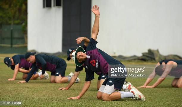 Joe Root of England stretches before the second day of the match between a Sri Lanka Board President's XI and England at P Sara Oval on March 13,...