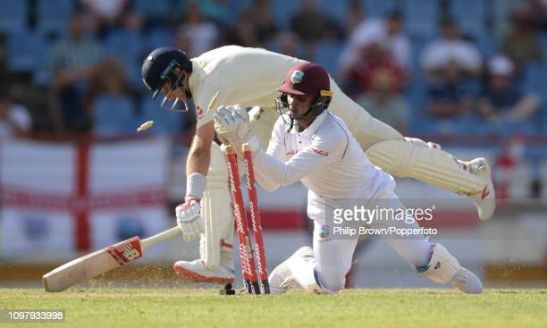 Joe Root of England survives a run out attempt from Shane Dowrich of the West Indies during the third day of the third test match between the West...