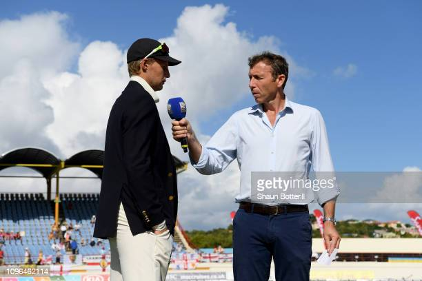 Joe Root of England talks to Michael Atherton of Sky Sports of Sky Sports during Day One of the Third Test match between the West Indies and England...